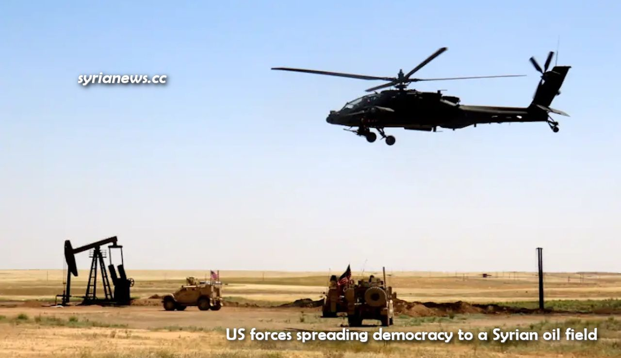US army armored vehicles and helicopter democratizing Syrian oil field.jpg