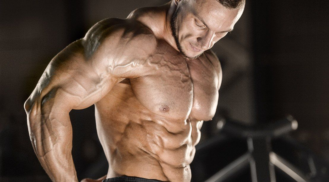 muscular_bodybuilder_showing_his_shoulders_muscle_after_a_delts_workout_routine.jpg
