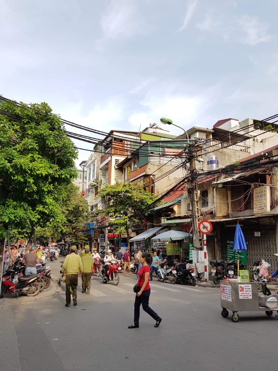 Hanoi, Vietnam. So many people! And, there are very few traffic lights.