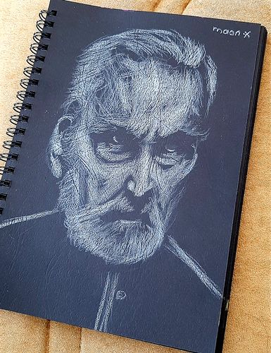 Portrait Drawing on Black Paper: An Aggressive Man