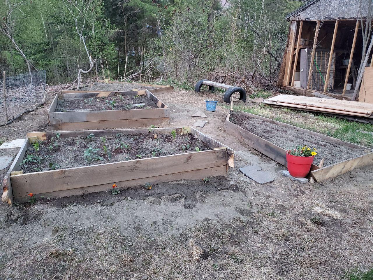 part disassembled barn and garden beds.jpg