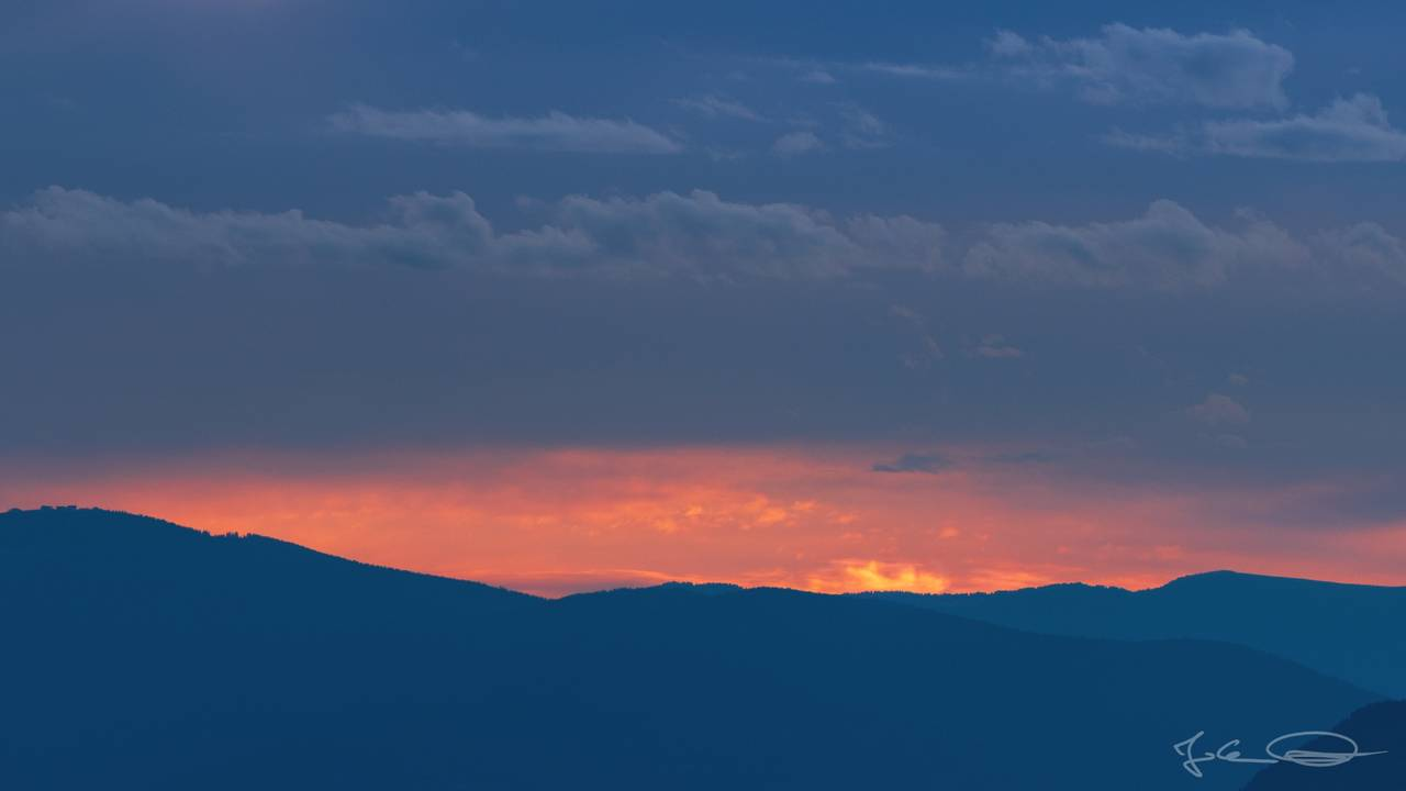 Fire on the Horizon - Sunset at the Sunvillage of Diex