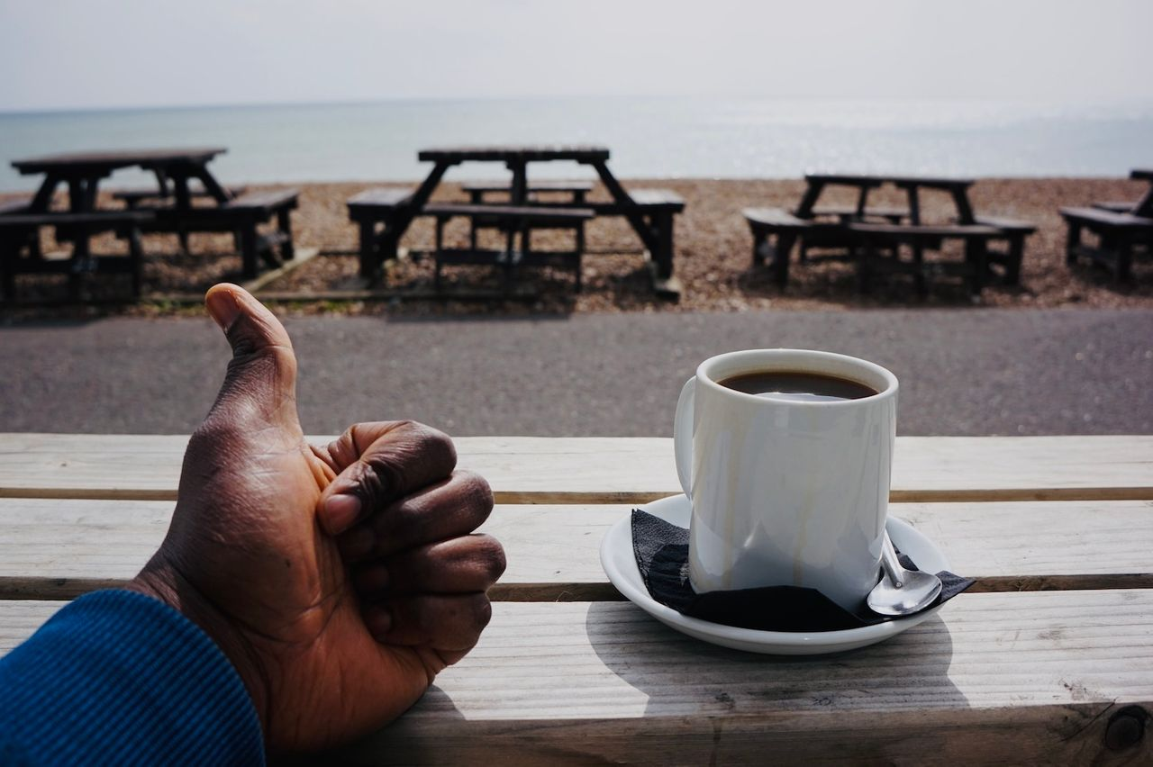 Sitting outside a beach cafe in Hove with my hot cup of black coffee