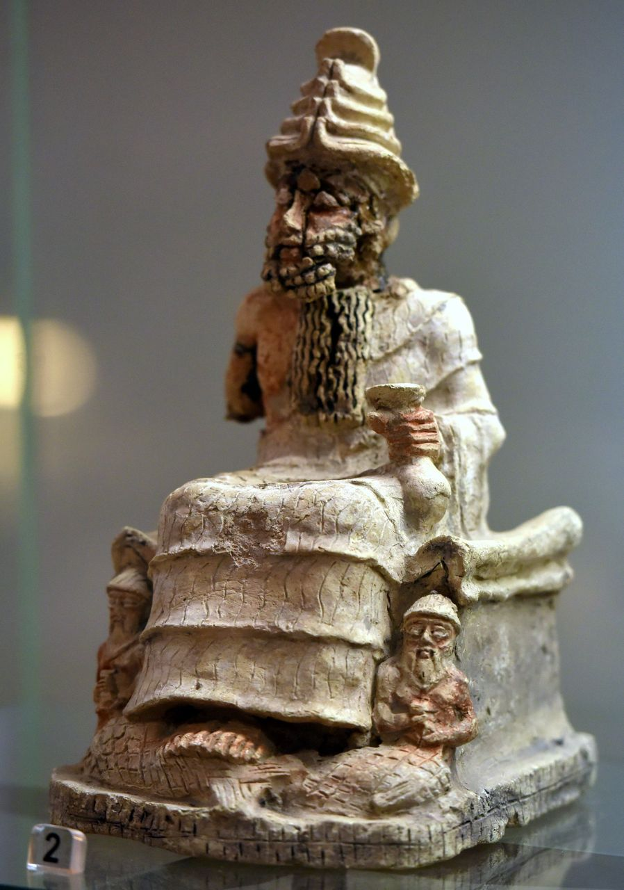 God_Ea,_seated,_holding_a_cup._From_Nasiriyah,_southern_Iraq,_2004-1595_BCE._Iraq_Museum CC.jpg