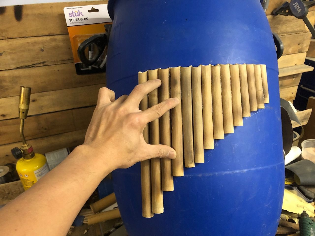 Making a pan flute with bamboo using a plastic barrel