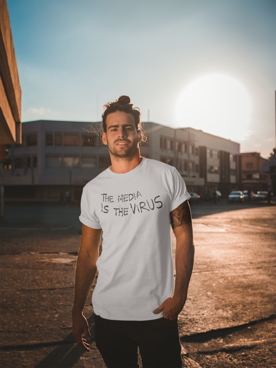 mockup-of-a-man-wearing-a-t-shirt-with-roll-up-sleeves-on-the-street-a19933_1024x1024@2x.png