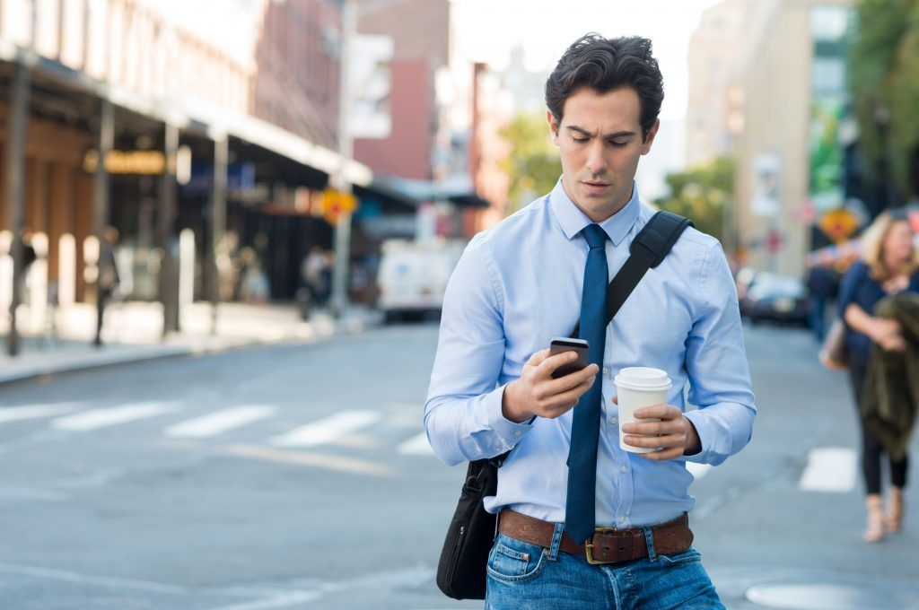 Man-walking-with-Phone.jpg